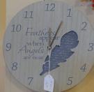 horloge plume